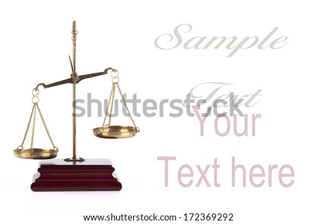 Golden scales of justice isolated on white background - stock photo