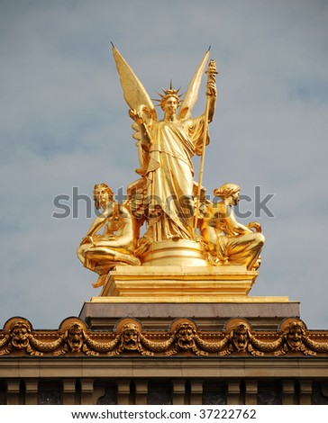 Golden sculptural group of a female angel holding a harp on the roof of the Opera Garnier, Paris, France. - stock photo
