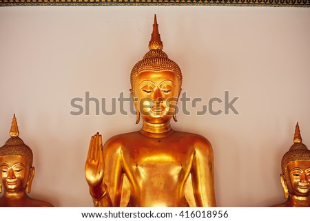 Golden sculptures of Buddha inside museum of historical monastery Wat Pho - stock photo