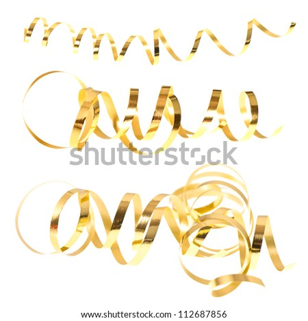 golden serpentine streamers isolated on white background. selective focus - stock photo