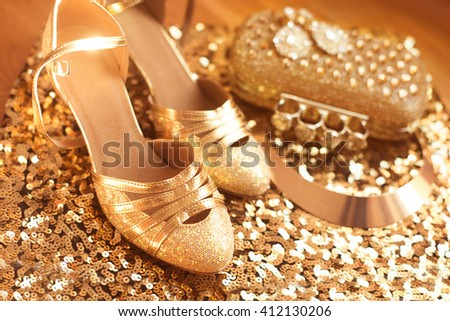 Golden. Shoes. Women's accessories. Luxury fashion  jewelry. Expensive pendant close-up background. Shiny Crystal Precious Gem Jewels - stock photo