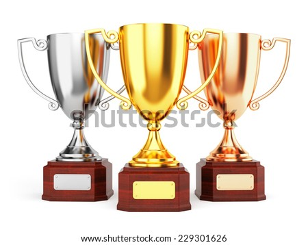 Golden, silver and bronze trophy cups isolated on white background. Three award goblet trophies. - stock photo