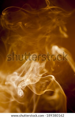 Golden smoke on black background
