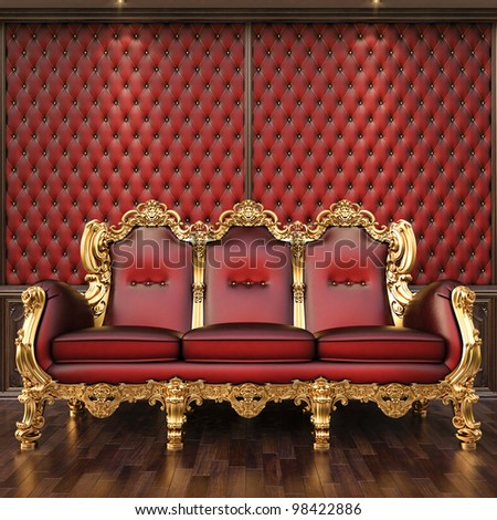 golden sofa in the luxurious interior. - stock photo