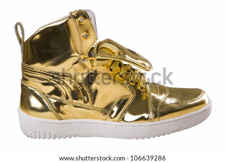 Golden sport shoes isolated on white background