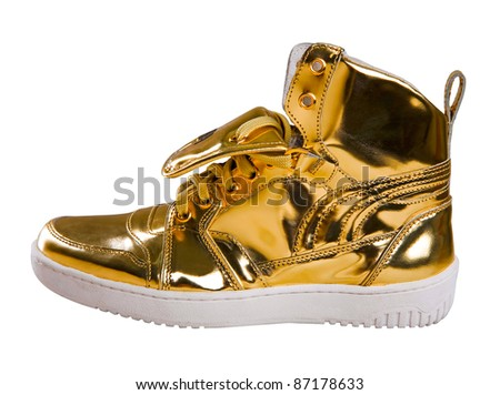 Golden sport shoes isolated on white background - stock photo