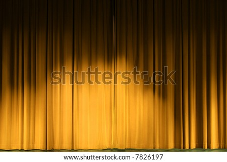 Golden Stage Curtains Drawn Before A Performance