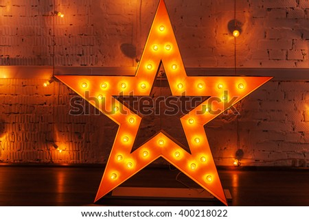golden star with light bulbs - stock photo