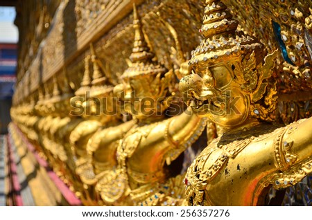 golden statue in wat phra keaw , Bangkok Thailand - stock photo