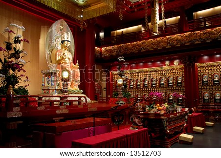 Golden statue of buddha inside a chinese temple