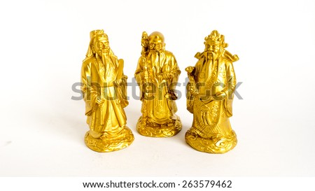 Golden statue of Chinese deities called Fu Lu Shou or Three Stars God. Concept of blessings, prosperity and longevity. Shot with natural light. Slightly defocused and close-up shot. Copy space.