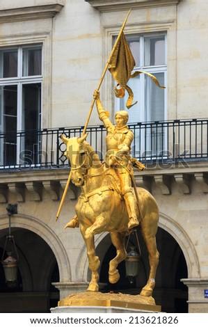 Golden statue of Joan of Arc on horseback - stock photo