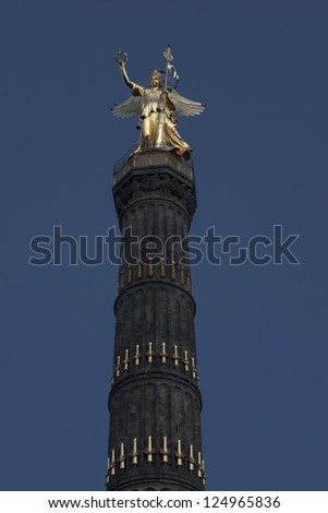 "Golden statue on Siegessaeule (Victory Column) in central Berlin. The column was built around 1860 in memory of 3 wars won by the Prussian army. The depicted goddess Viktoria is nicknamed ""Goldelse""."