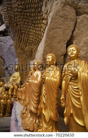 Golden statues of Buddha in carving in Ipoh, Malaysia, Asia. - stock photo