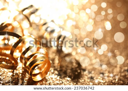 Golden streamers on abstract background,Closeup. - stock photo