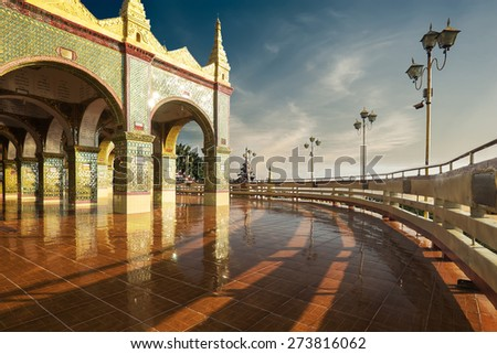 Golden Su Taung Pyai Pagoda at Mandalay Hill. Amazing architecture of Buddhist Temples in Myanmar (Burma). Travel landscapes and destinations - stock photo