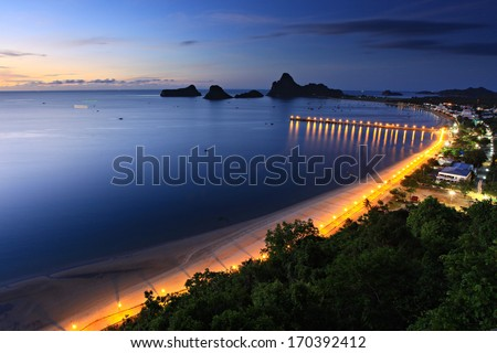 Golden sunrise on the tropical beach of Prachuap Khiri Khan, Southern Thailand. Aerial view from Khao Chong Krajok temple top view point.  - stock photo