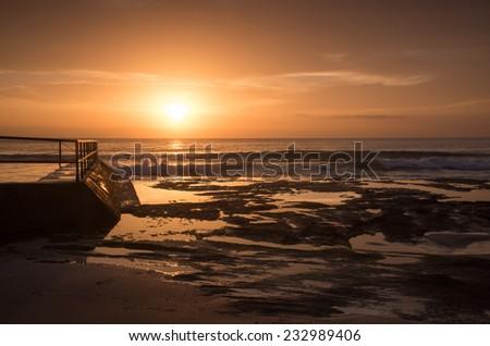 Golden Sunrise over the Pacific ocean - stock photo