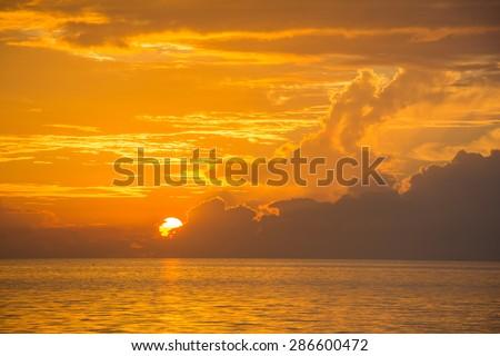 Golden sunset in Maldives - stock photo