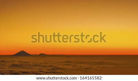Golden Sunset Mount Agung, view from Senaru Rim Mount Rinjani, Lombok, Indonesia with meteor on top of frame - stock photo