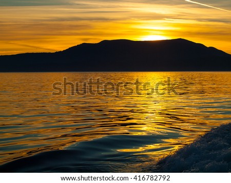 Golden Sunset on the Water Traveling on a Boat - stock photo
