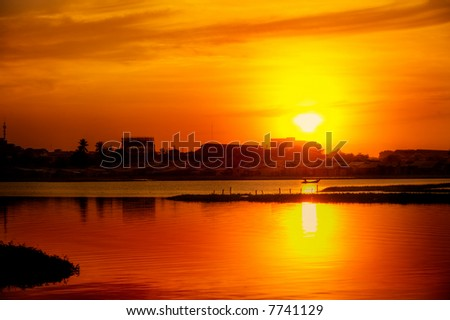 Golden sunset over lake in South East Asia