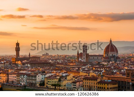 Golden sunset over Palazzo Vecchio and Cathedral of Santa Maria del Fiore (Duomo), Florence, Italy - stock photo