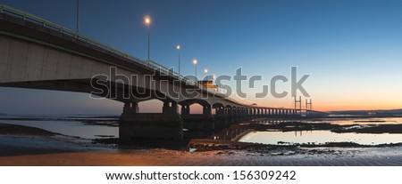 Golden sunset over the Second Severn Bridge providing a vital link for England and Wales. - stock photo