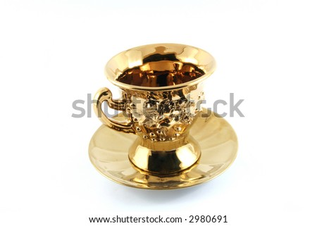 golden tea cup with plate