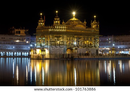 Golden Temple reflection at night, Amritsar India - stock photo