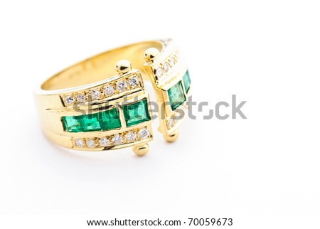 golden tourmaline ring isolated against a white background - stock photo