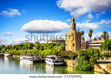 Golden tower (Torre del Oro) along the Guadalquivir river, Seville (Andalusia), Spain.  - stock photo