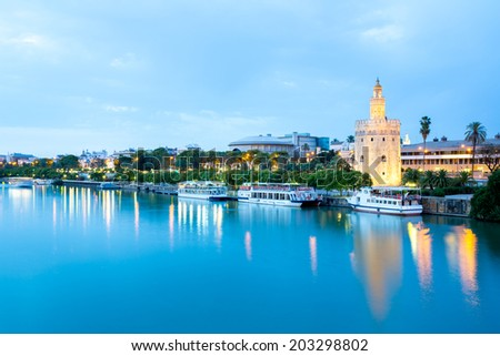 Golden Tower with cityscape and river of Sevilla sunset Seville, Spain - stock photo