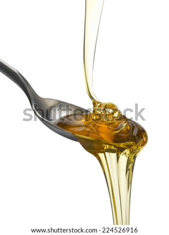 Golden Treacle flowing onto spoon