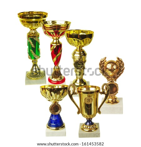 Golden trophy prizes isolated on white - stock photo
