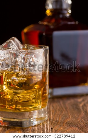 Golden Whiskey with Fine Crystal Whiskey Bottle - stock photo