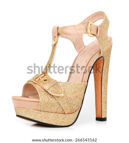 Golden woman shoes isolated on the white background - stock photo