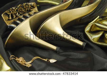 golden womans shoes and accessories - stock photo