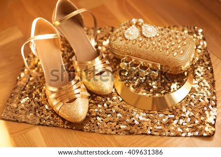 Golden. Women's clothes and accessories.  Shoes. Luxury fashion  jewelry. Expensive pendant close-up background. Shiny Crystal Precious Gem Jewels - stock photo