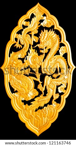 Golden wood dragon carving isolated on black background,with clipping path - stock photo