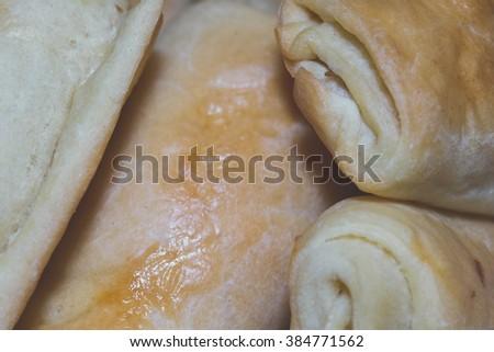 Golder pasties with sauerkraut and mushrooms - stock photo