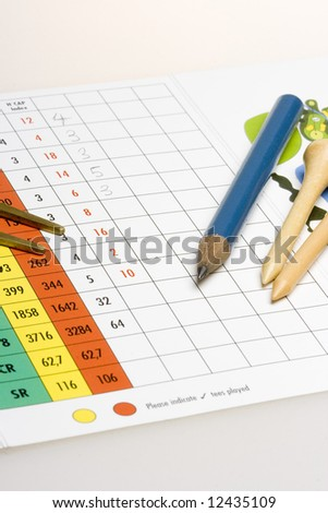 Golf accessories and pencil on a golf scorecard - stock photo