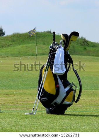 Golf bag on a field - stock photo