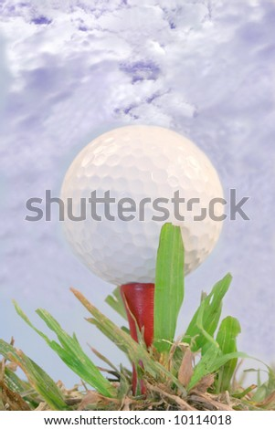 Golf ball against blue sky - stock photo