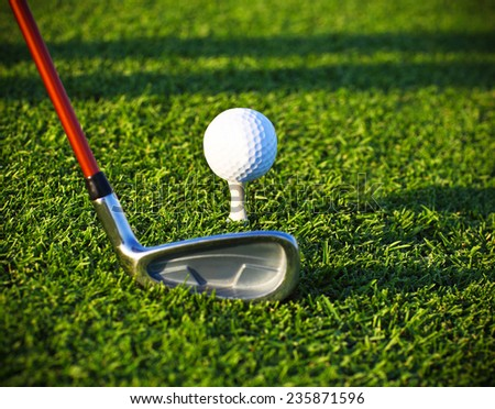 Golf ball and driver on a golf course. Close up - stock photo