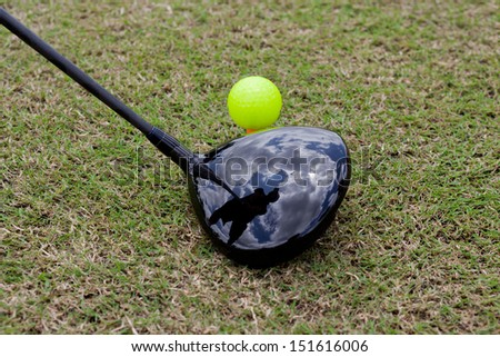 Golf Ball and Driver with the reflex of Player prepare for Play - stock photo
