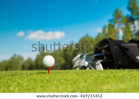 Golf ball and golf bag club on the course with beautiful background