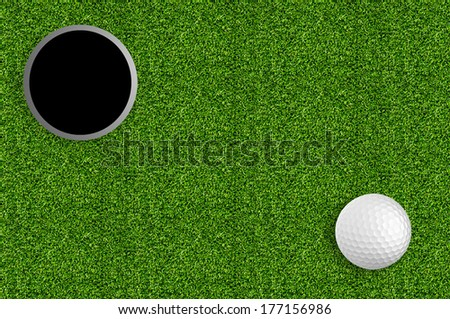 golf ball and hole on the green grass of the golf course - stock photo