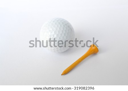 golf ball and wooden tee, sport time - stock photo