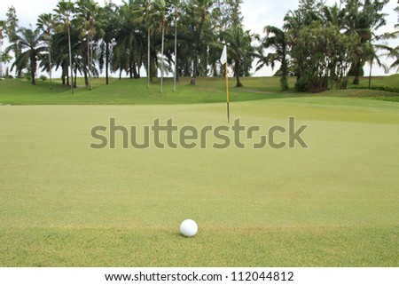 golf ball at the green ready for putting - stock photo